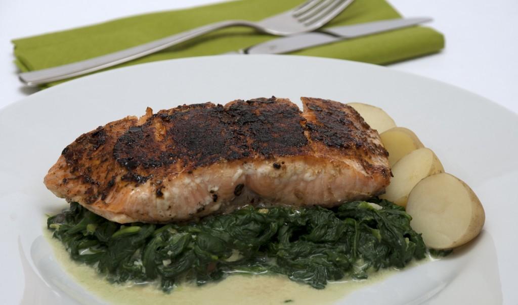 peri-peri salmon on creamy greens