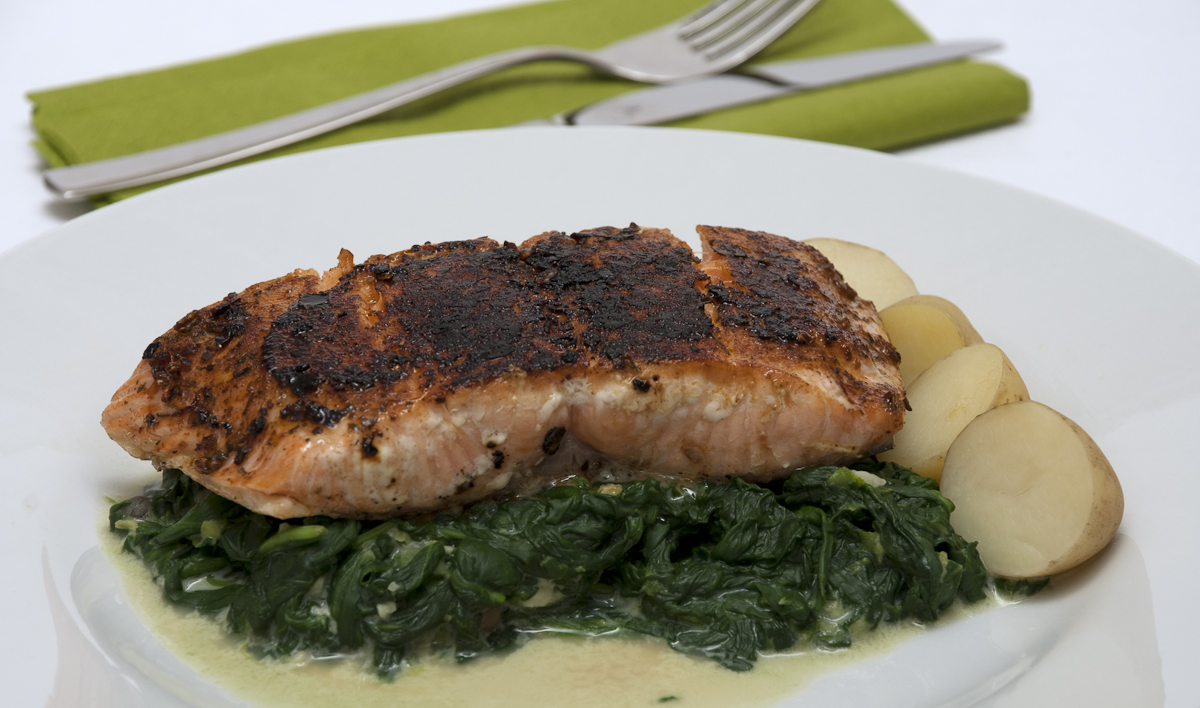 peri-peri salmon on creamy greens